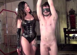 Tall Dominatrix Torments Victim with..