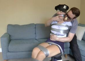 brdrlnds police doll duct taped up..