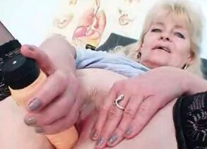 Old ash-blonde mature demonstrates off..